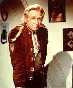 Lloyd Bridge as Com. Cain.